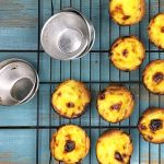 Portuguese Custard Tart sitting on a cooling rack