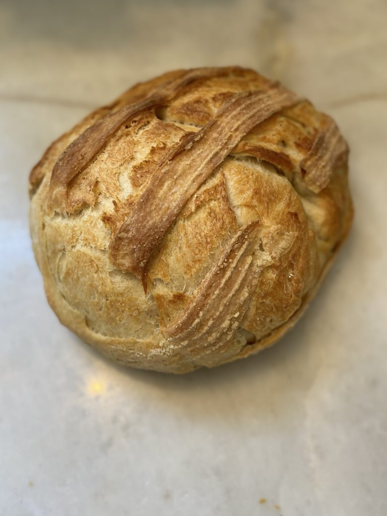 back image of the olive oil bread sitting on a marble surface
